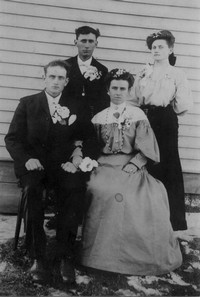 Newlyweds Joseph and Delphine Ouimet (front) with Best Man and Maid of Honor